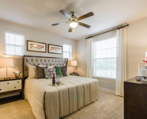 Kathy Andrews Interiors Grand at the Dominion Multifamily Model Bedroom