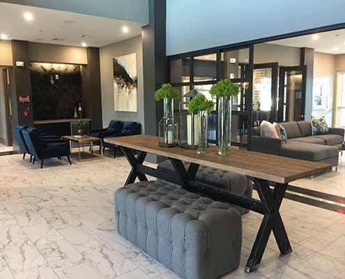 Kathy Andrews Interiors Multifamily Interior Design Streamsong Lobby Entrance 1