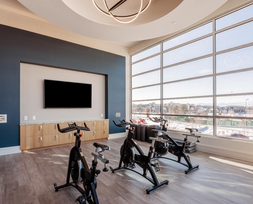 Kathy Andrews Interiors Multifamily Interior Design Leasing and Amenity Center Encore at Boulevard One Spinning Studio