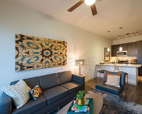 Kathy Andrews Interiors Student Housing Interior Design Dinerstein Companies Sterling Northgate College Station TX Model Living Area cropped