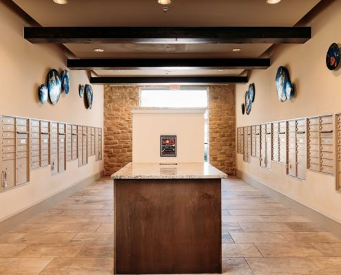 Kathy Andrews Interiors Ridgeline at Rogers Ranch Multifamily Leasing and Amenity Center Mailroom