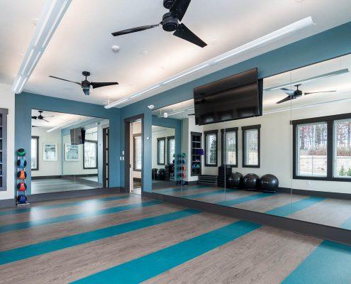 Active Adult Living Community Spaces -Yoga Room 1 Kathy Andrews Interiors - David Weekley Homes Encore at Briar Chapel