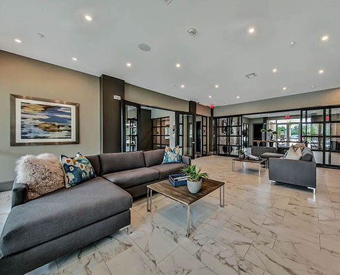 Kathy Andrews Interiors Multifamily Interior Design Streamsong Resident Lounging Area cropped