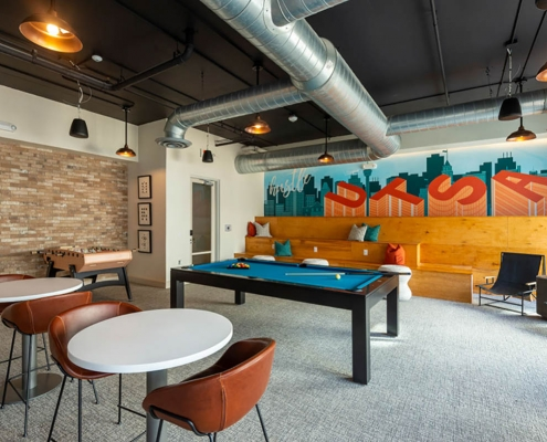Kathy Andrews Interiors Student Housing Leasing and Amenity Center Interior Design Sterling Heights Game Room