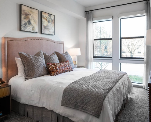 Kathy Andrews Interiors Multifamily Mid Rise and High Rise Interior Design Heights Waterworks Model Unit Bed Room