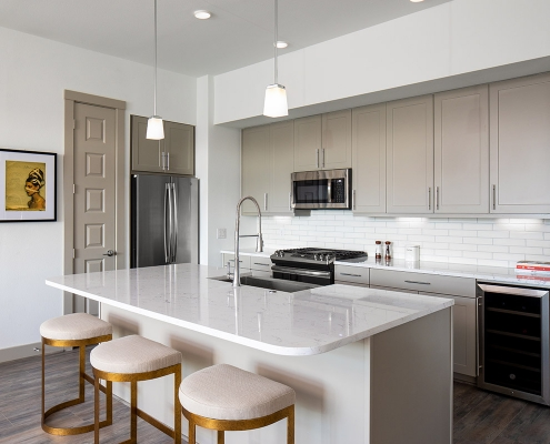 Kathy Andrews Interiors Multifamily Mid Rise and High Rise Interior Design Heights Waterworks Model Unit Kitchen 2